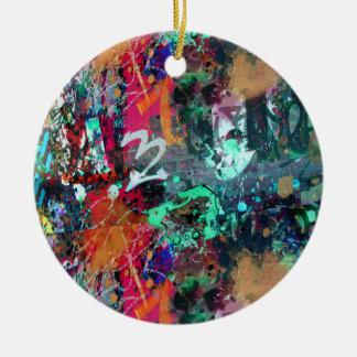 Salpicadura de la pintada y de la pintura adorno navideño redondo de cerámica