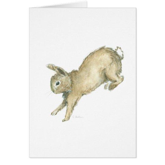 Saltando la tarjeta de nota en blanco del conejito
