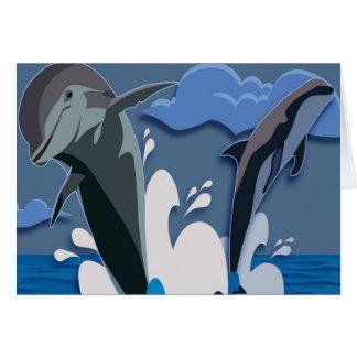 Salto del mar de los delfínes que nada la foto div tarjetas