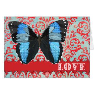 Saludo rojo del damasco del amor azul de la tarjeta de felicitación