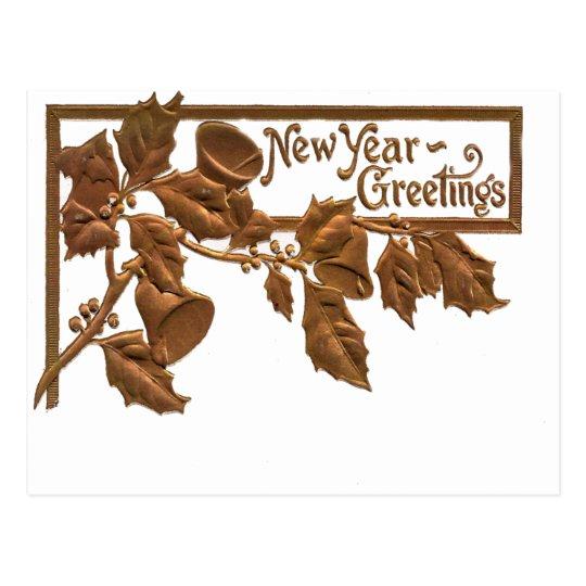 Saludos de oro del Año Nuevo del acebo del Postal