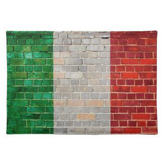 Salvamanteles Bandera de Italia en una pared de ladrillo