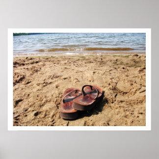 Sandalias en el poster de la playa