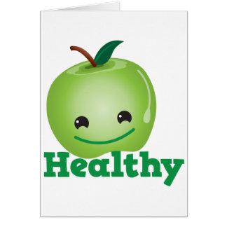 Sano con la manzana verde del kawaii con una cara  tarjeta de felicitación