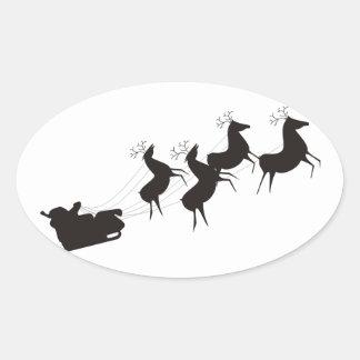 Santa blanco y negro y su trineo pegatina ovalada
