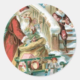 Santa con el trineo y presentes para los niños pegatinas