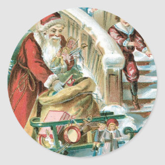 Santa con el trineo y presentes para los niños pegatina redonda