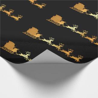 Santa de oro en el papel de embalaje negro de