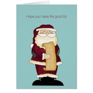 Santa divertido con la tarjeta de felicitación del