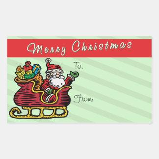 Santa divertido en su trineo etiqueta