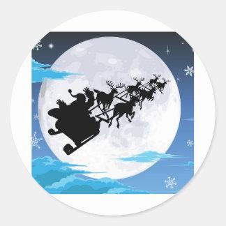 Santa en silueta del trineo contra la Luna Llena Etiquetas