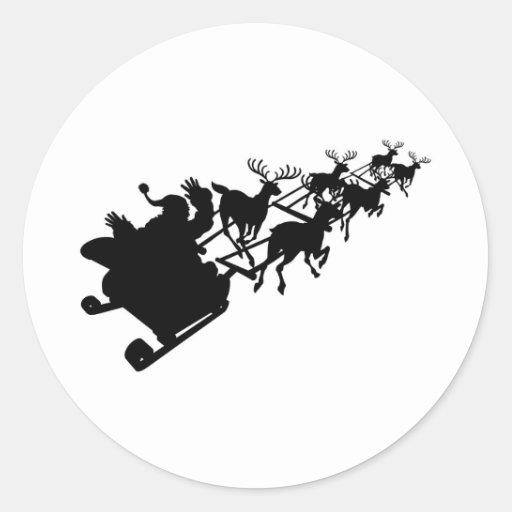 Santa en su navidad trineo o silueta del trineo etiqueta redonda