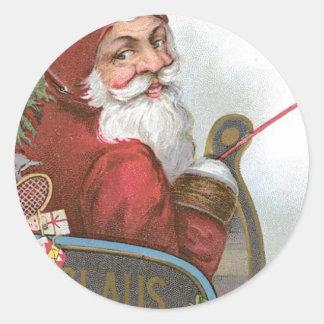 Santa en su trineo en navidad pegatinas redondas