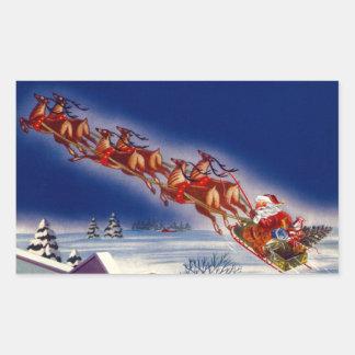 Santa en su trineo pegatina rectangular