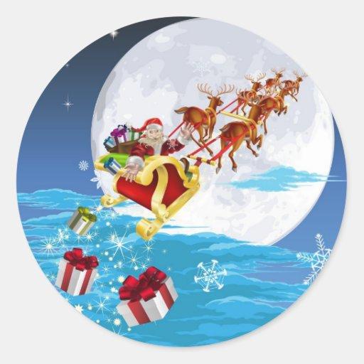 Santa en su trineo pegatina redonda