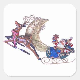 Santa en su trineo calcomanias cuadradas