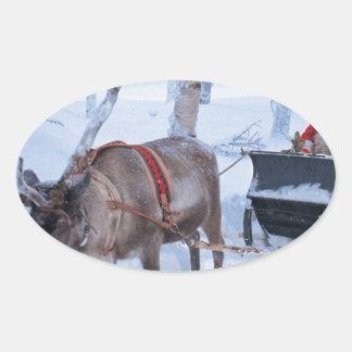 Santa en su trineo pegatina oval personalizadas