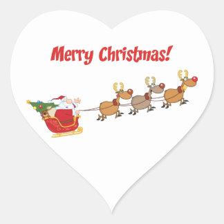Santa en su trineo pegatina en forma de corazón