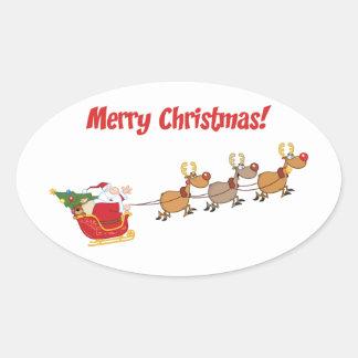 Santa en su trineo pegatina ovalada