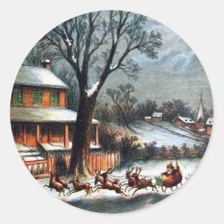 Santa en trineo con el reno pegatina redonda