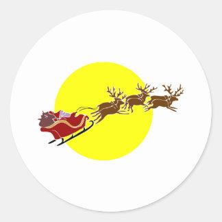 Santa en trineo pegatina redonda