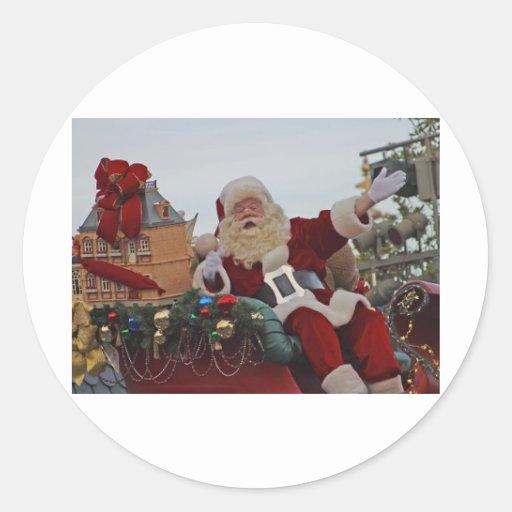 Santa en un trineo pegatinas redondas
