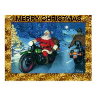 Santa en una postal del navidad de la motocicleta