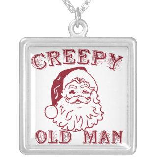 Santa es un viejo hombre espeluznante colgantes