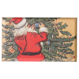 Santa que adorna el árbol de navidad soportes para tarjetas de mesa