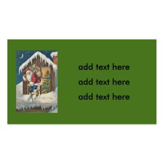Santa que sale del árbol de navidad de la casa tarjetas de visita