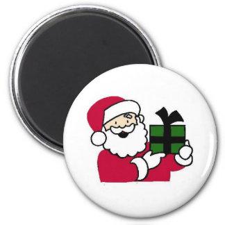 Santa que sostiene el regalo imán redondo 5 cm
