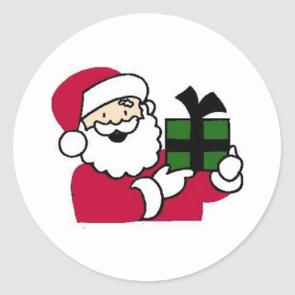 Santa que sostiene el regalo pegatina redonda
