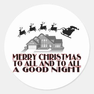 Santa que vuela durante buenas noches del navidad pegatina redonda