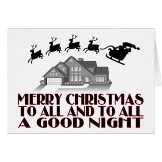 Santa que vuela durante buenas noches del navidad tarjeta de felicitación