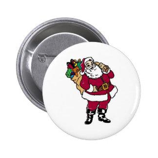 Santa sostiene los juguetes chapa redonda de 5 cm