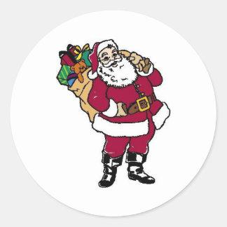 Santa sostiene los juguetes pegatina redonda