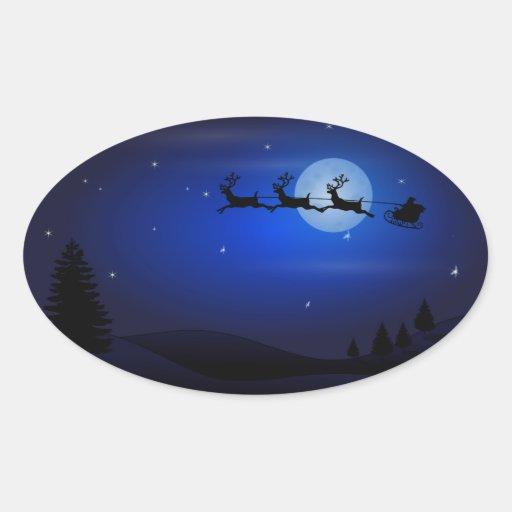 Santa, trineo, reno, y paisaje iluminado por la colcomanias de oval