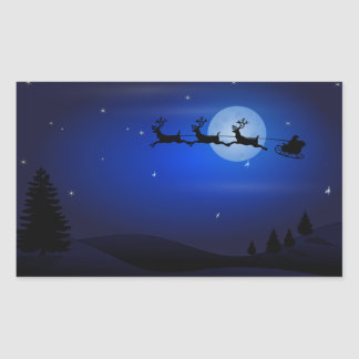 Santa, trineo, reno, y paisaje iluminado por la pegatina rectangular