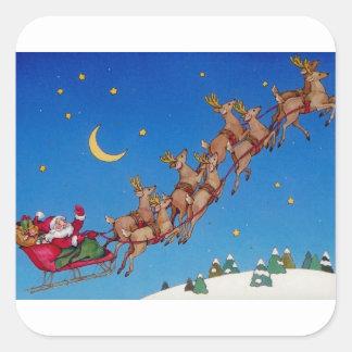 Santa y su trineo calcomanía cuadrada