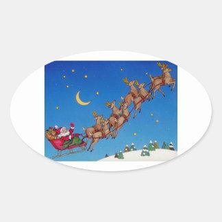 Santa y su trineo calcomanías ovales