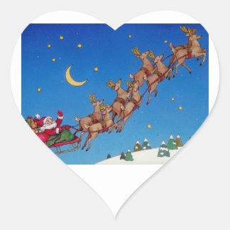 Santa y su trineo pegatina en forma de corazón