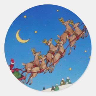 Santa y su trineo pegatina redonda