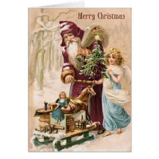 Santa y tarjeta de Navidad del vintage del ángel