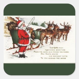Santa y trineo con verde del reno pegatina cuadrada