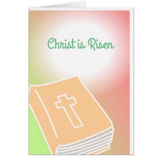 Se sube la biblia cruzada Cristo de la tarjeta de