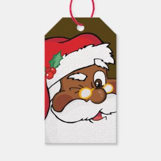 Secreto que guiña a Papá Noel negro la etiqueta de