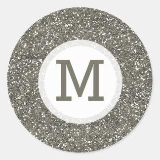 Sello de plata brillante del monograma del brillo