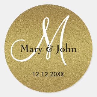 Sellos trémulos del monograma del boda del oro