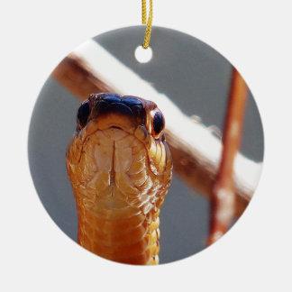 serpiente adorno navideño redondo de cerámica