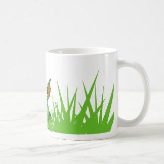 Serpiente en la taza de la hierba